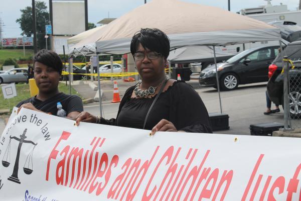 Debbie Williams, center, came to Ferguson from Detroit, Michigan.
