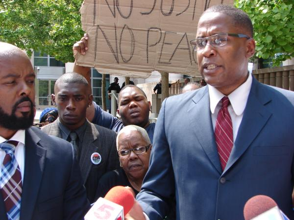 Black Lawyers for Justice president and attorney Malik Shabazz speaks outside the U.S. District Courthouse in St. Louis on Thursday.