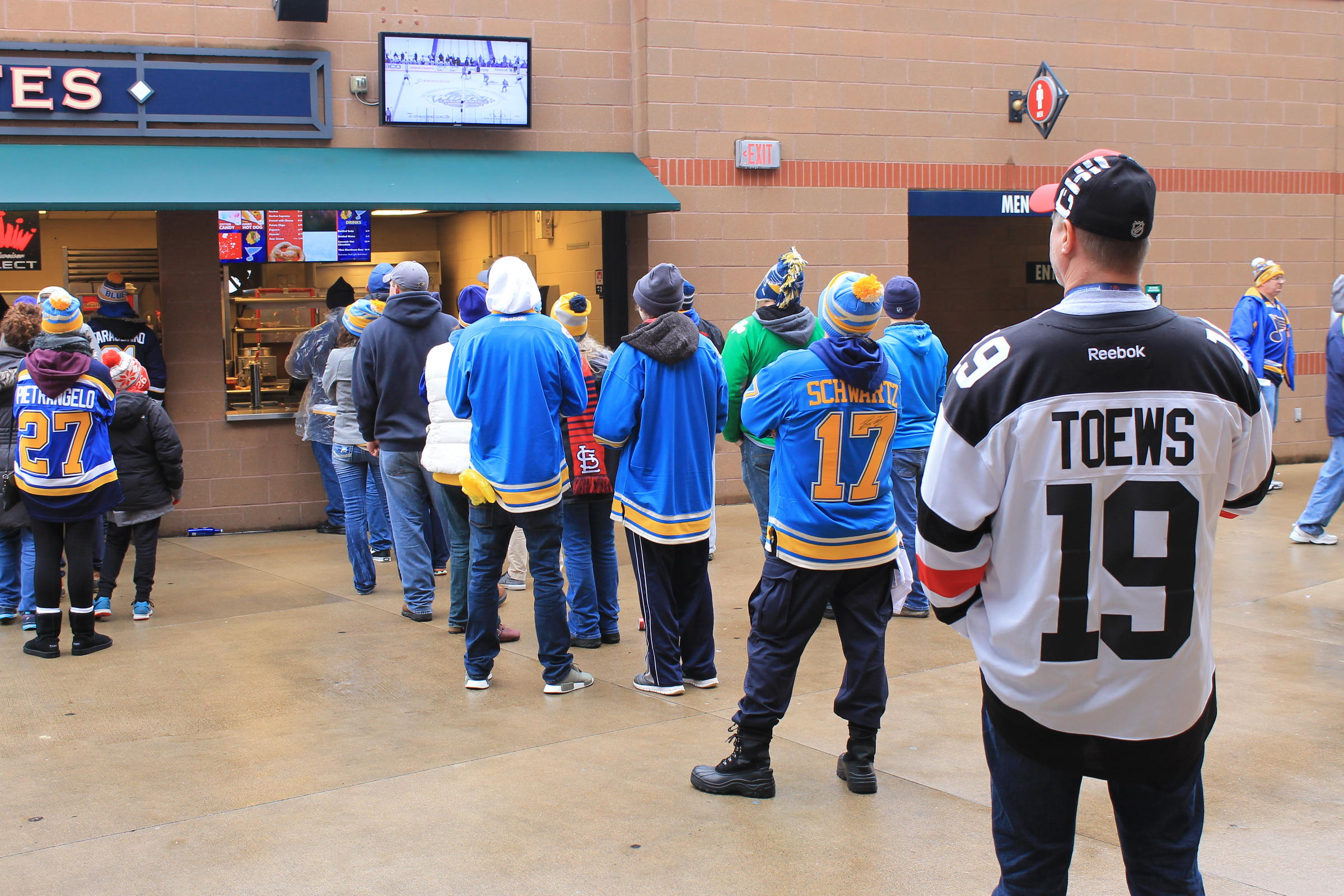 Some of the sellout Winter Classic crowd waiting in line for food while keeping an eye on the game at Busch Stadium on Jan. 2 2017