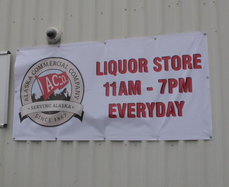 Sign outside the AC Quickstop liquor store.