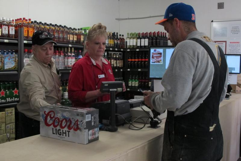 Opening day of AC Quickstop liquor store.