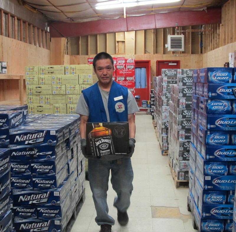 Reno Moore pulling stock on opening day of the AC Quickstop liquor store.