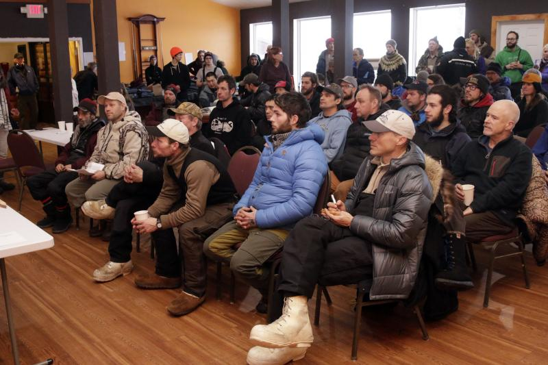 Mushers listen to rules and trail conditions for the Kuskokwim 300 Sled Dog Race in the Bethel Long House Hotel on January 19, 2017. Roger Lee is sitting in the front, right corner, taking notes.