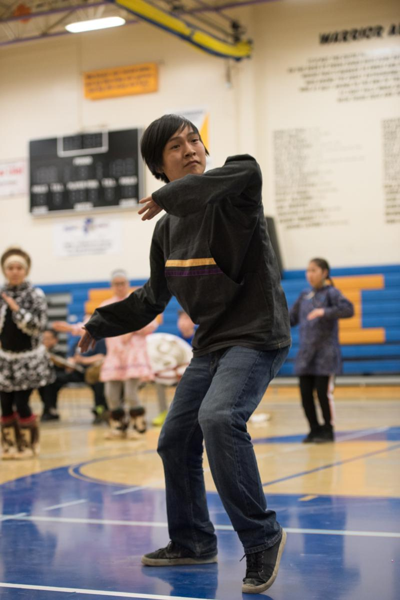 A dancer from the Kuskokwim Learning Academy joins the Atmautluak dancers at the LKSD Yuraq Festival in Bethel on April 29, 2017.