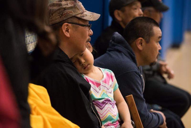 A young spectator rests during the three-day LKSD Yuraq Festival. Students continued to dance until after midnight in the Bethel Regional High School gym on April 29, 2017.