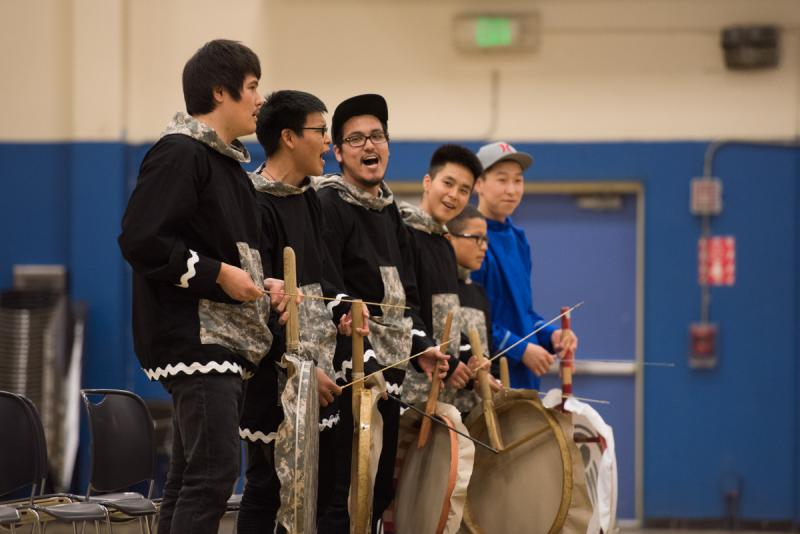 Drummers from Atmautluak stand for their last song at the LKSD Yuraq Festival in Bethel on April 29, 2017.
