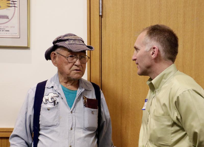 Bethel resident and Calista shareholder Elias Venes (left) talks with Donlin Gold General Manager Andy Cole (right) at a Donlin open house at the Bethel Cultural Center on May 10, 2017.