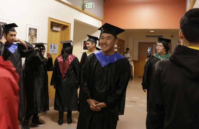 Kuskokwim Learning Academy students prep for their commencement walk at the Yupiit Piciryarait Cultural Center on Saturday, May 13, 2017.
