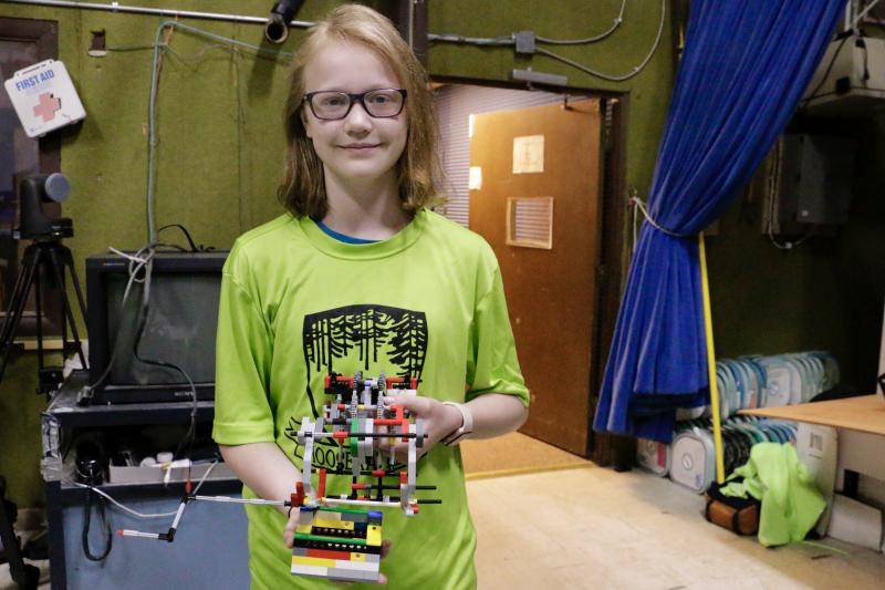 The Bethel Robotics team, known as the Mooskateers, traveled nearly three thousand miles and enjoyed competing in the National Robotics Championship in San Diego, California. Pictured here, team member Jordan Wheeler, holding a component of the robot.