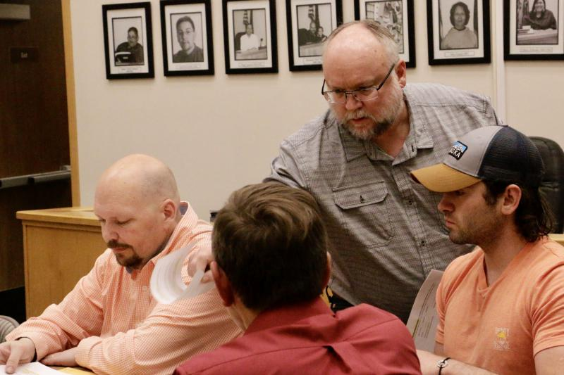 The Bethel Planning Commission has held to their initial decision to turn down Steven Chung's Tundra Liquor Cache application for a conditional use permit. Pictured here are Commission Member Jon Cochrane (left), Planning Director Ted Meyer (center), and