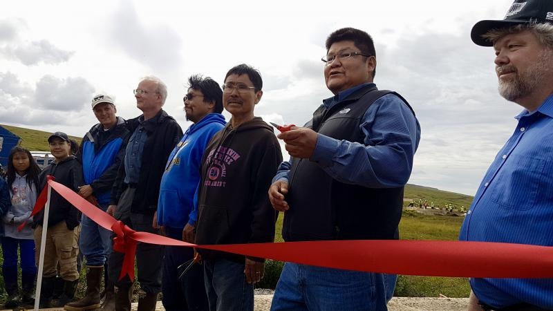A Newtok Village Council Elder gathered with financial and government stakeholders at the Mertarvik site for the ribbon cutting ceremony on August 10, 2017.
