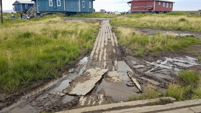 Parts of the boardwalks in Newtok are damaged due to the land sinking beneath them.