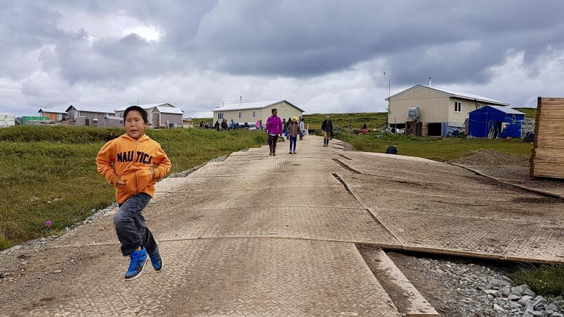 Excited Newtok children sprint down to Mertarvik's newly extended boat harbor.
