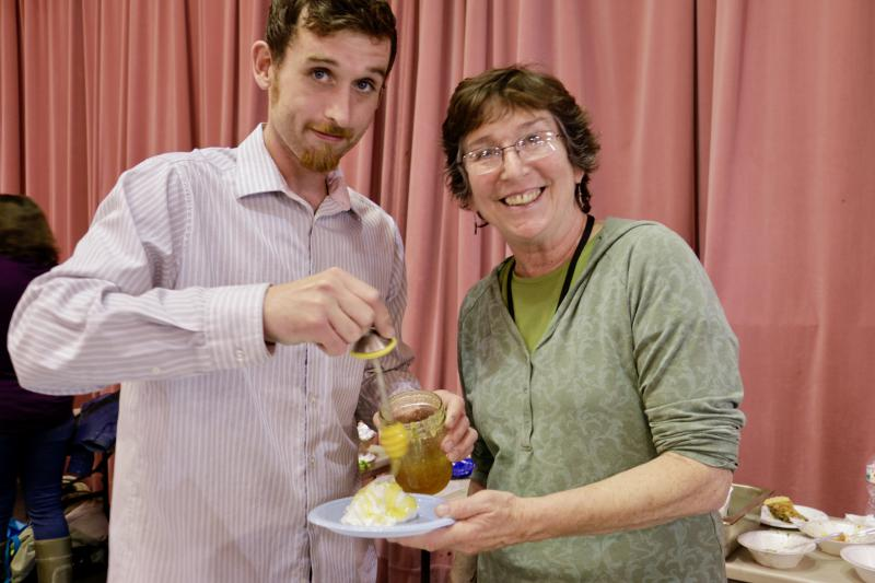 Event organizer Reyne Athanas prepares a traditional Greek dessert with her son.