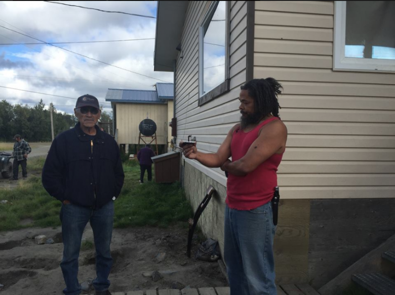 Akiak Native Community Chief Ivan M. Ivan confronts Jacques Cooper at his home on Sunday, August 20.