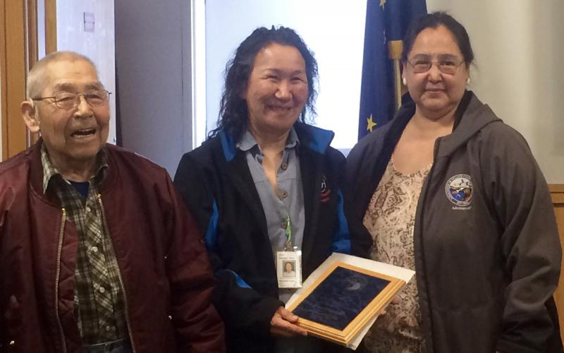 Rose Domnick receives AVCP's 2017 Healing Hands Award for her work directing YKHC's Calricaraq program. AVCP Traditional Chief Peter Moore and CEO Vivian Korthuis present her with the honor on September 28, 2017.