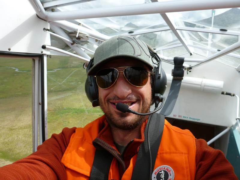 ADF&G Kuskokwim Area Management Biologist Aaron Tiernan flies an aerial king salmon survey over the Arolik River.