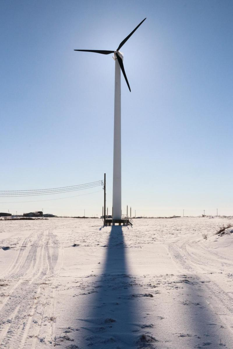 A wind turbine stands outside the Yukon-Kuskokwim Fitness Center. AVEC is working to erect another, larger, 900 kilowatt wind turbine in Bethel.