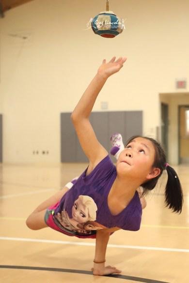 Teana Pavilla of Kasigluk's Akiuk Memorial School took second place in the Junior High School Girls One-Arm Reach, smacking a ball suspended 36 inches from the ground with one hand while balancing her body on the other hand.