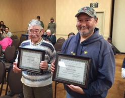 James Charles of Tuntutuliak (left) and Ray Oney of Alakanuk (right) receive the ADF&G Excellence in Service Award at the Alaska Board of Game meeting in November 2017.