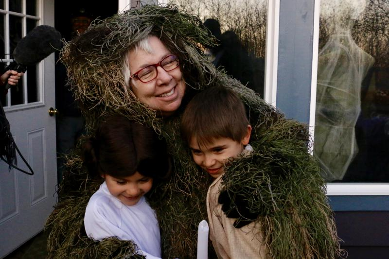 After giving kids a good fright, Bev Hoffman emerges from her hiding spot to give Trick or Treaters a hug.