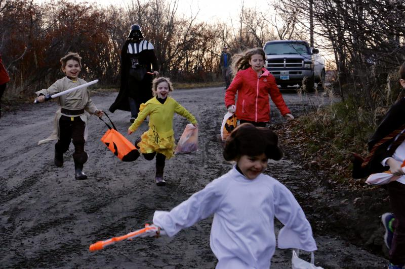 Trick or Treaters sprint to Bev Hoffman and John McDonald's haunted house.