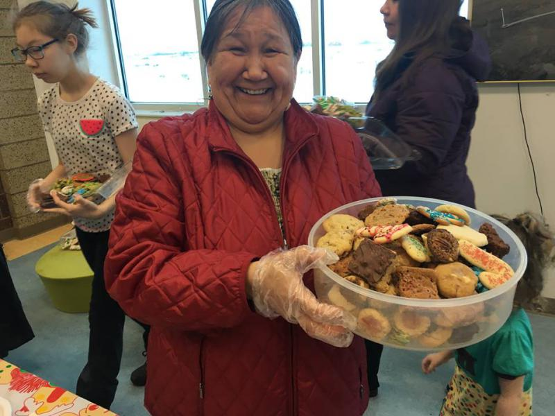 Joanne Evon collects cookies at the 24th Annual Christmas Cookie Extravaganza at the Yukon-Kuskokwim Fitness Center on December 17, 2017.
