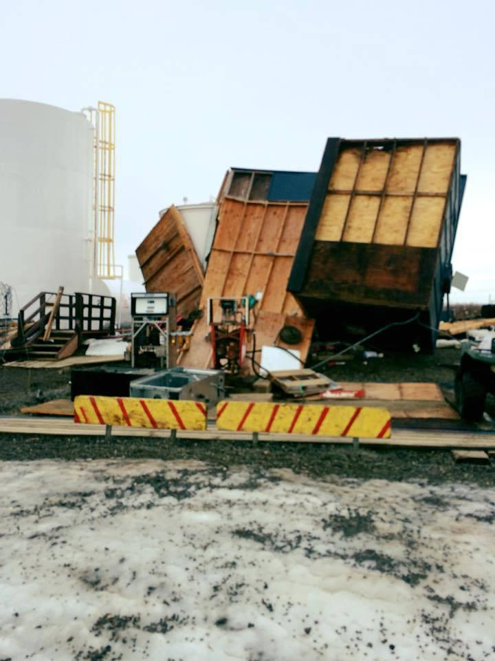 Eighty-five mile per hour winds blew over the Quinhagak fuel storage warehouse with an employee inside on Friday, December 22, 2017.