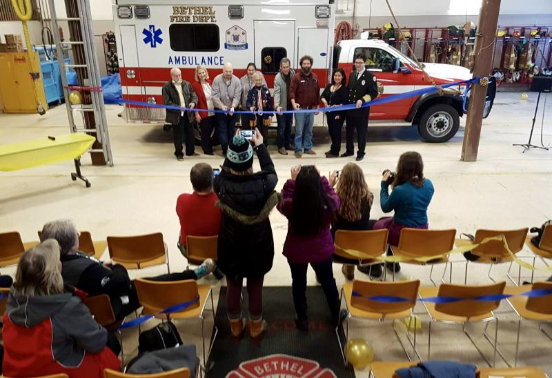 The Bethel Fire Department, joined by its community partners and sponsors, cuts the dedication ribbon for the Medic Six ambulance on December 15, 2017.