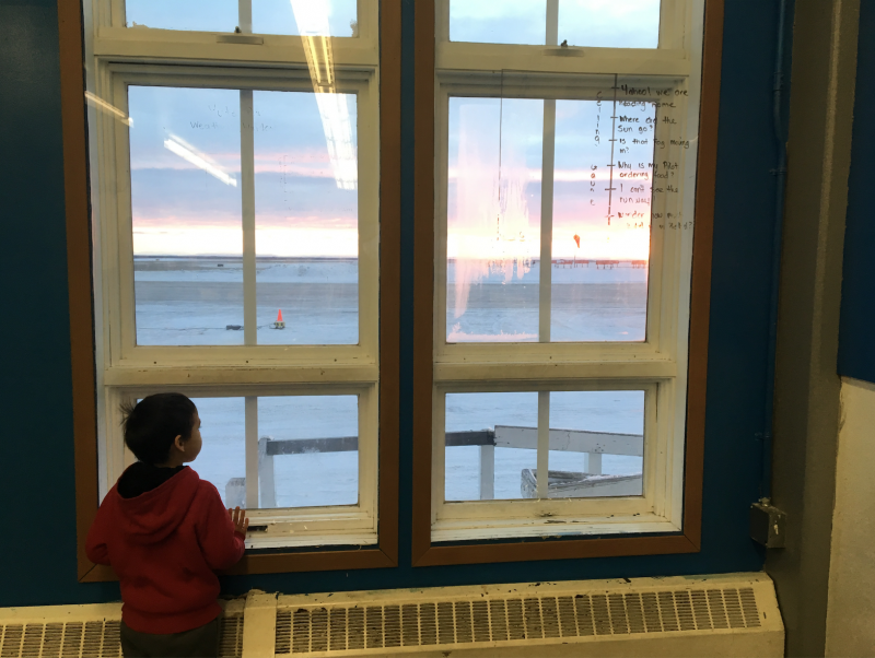 A young Yute Commercial Services passenger watches planes land from the new airline's terminal.