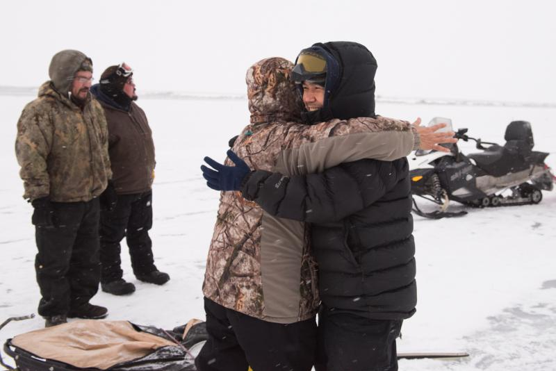 Maurice Andrews hugs his mom, Mary Simon, after winning the Kuskokwim 300 Season Opener on Saturday, December 30, 2017.