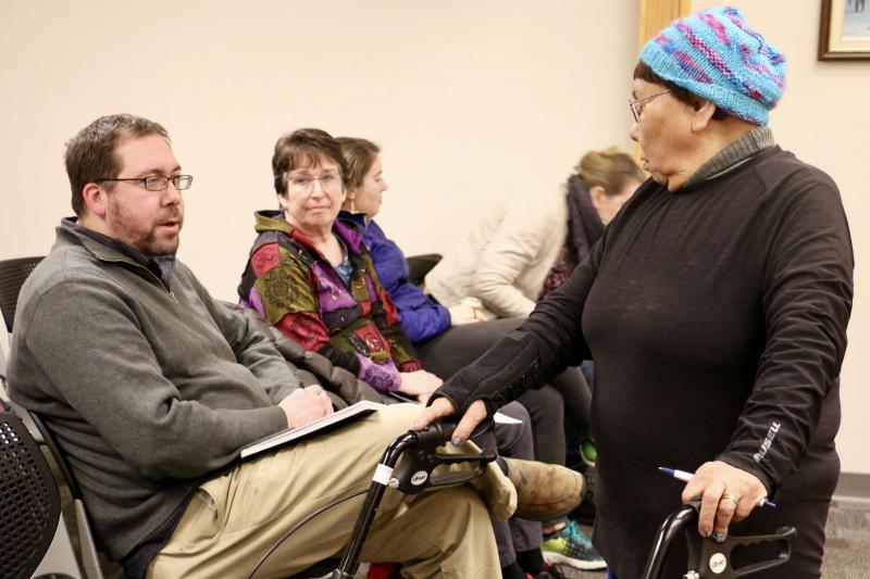 District 38 Representative Zach Fansler speaking with Bethel resident Mary Nanuwak at the December 12, 2017 Bethel City Council meeting. Fansler is accused of hitting a woman when she tried to leaveh is hotel room.
