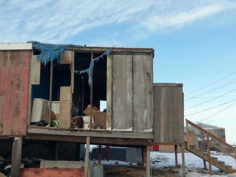 Quinhagak is applying for aid to repair damage after 85-mile-per-hour winds ripped through the community days before Christmas. The storm tore away the porch and wall from this house.