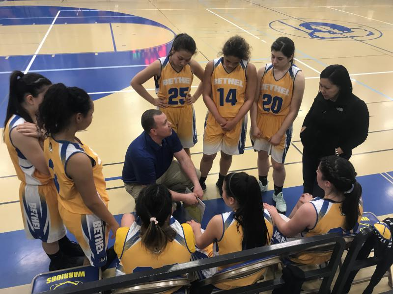 Bethel coaches Eric Jung and Melony Fredricks talk with the Warrior girls basketball team during their game against the Barrow Whalers on February 3, 2018.