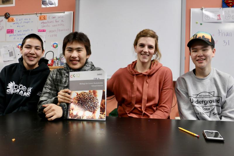 Chefornak High School students pictured with their new CK-12 Foundation biology textbook. From left to right: Matthew Erik, Clayton Panruk, biology teacher Theresa Schallhorn, and Dawson Erik. Picture taken December 16, 2017.