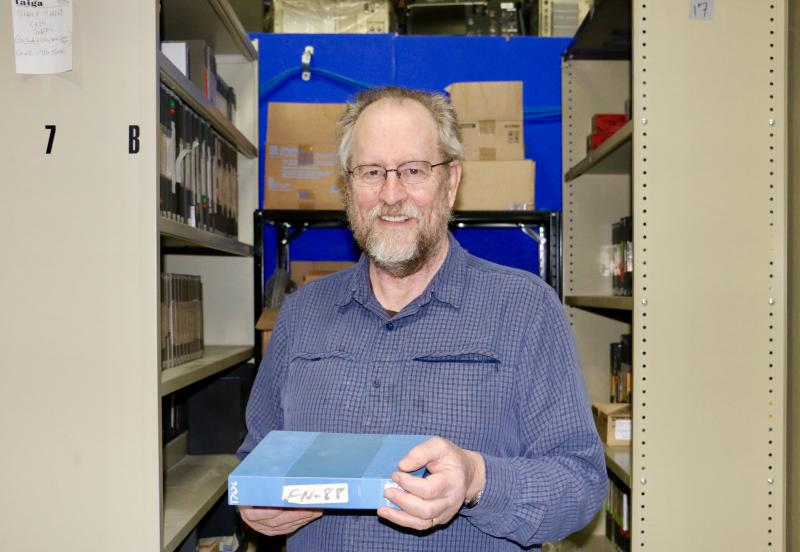 Former KYUK General Manager John McDonald has begun the long process of organizing, cataloguing, and packing the KYUK 5,000-piece video collection for shipment to Anchorage where they'll be preserved. He is pictured here in the KYUK television studio on F