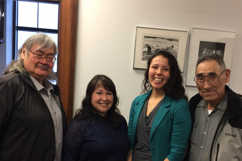 Legislative aides Michelle Sparck and Mary Aparezuk meet with constituents Willie Kasayulie and Ivan M. Ivan in Juneau.