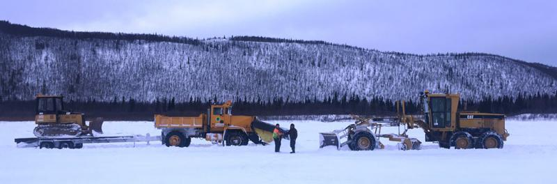 The Napaimute and Crooked Creek ice road crews shake hands after completing the longest Kuskokwim ice road ever on March 3, 2018.