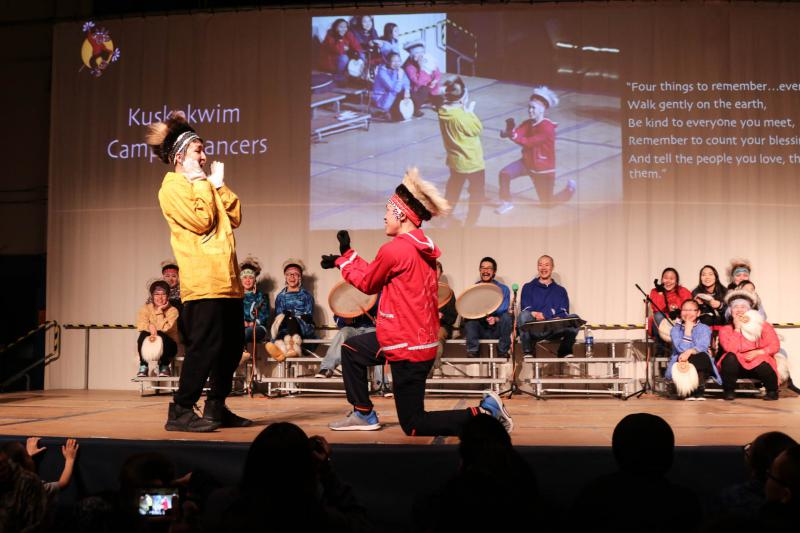 Two of the Kuskokwim Campus Dancers add comical flare to their yuraq.