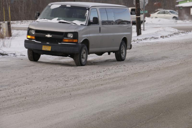 A van drives over a warped section of road on Bethel's Chief Eddie Hoffman Highway near Watson's Corner on March 12, 2018.