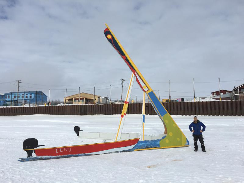 Eric Whitney stands next to the tripod he constructed for the Kuskokwim Ice Classic. The tripod was erected on the river ice in front of the Bethel seawall on March 21, 2018.