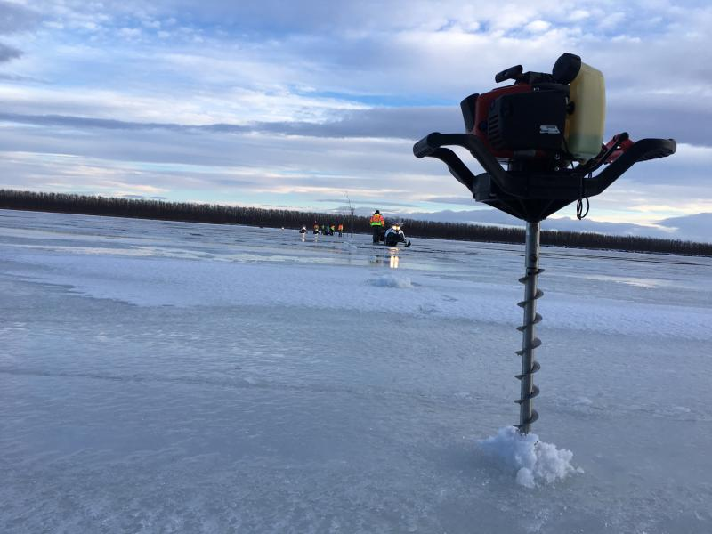 Bethel Search and Rescue measures the thickness of the Kuskokwim ice road.