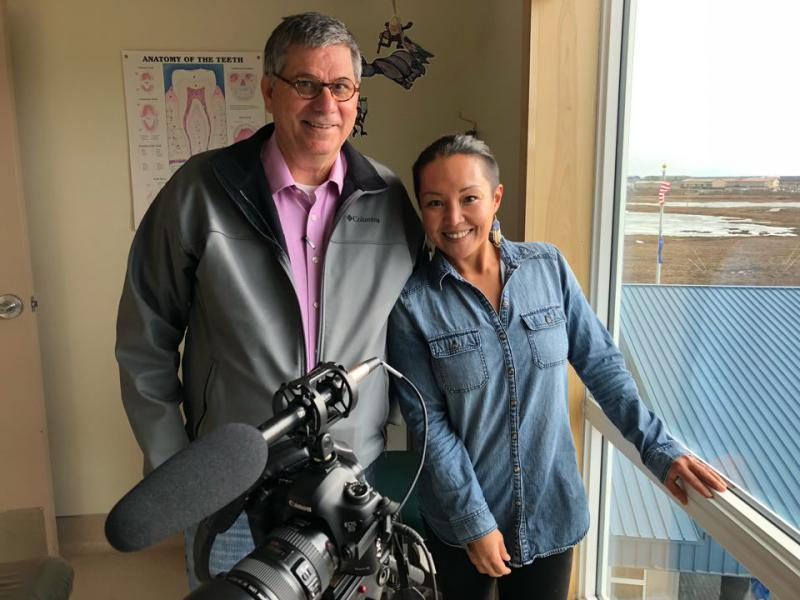 Mark Trahant (left) and videographer Jacqueline Cleveland (right) reporting for FNX on the Dental Health Aide Therapist program housed at Yuut Elitnaurviat in Bethel. May 3, 2018.