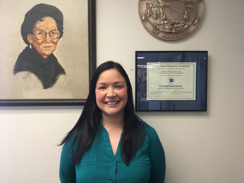 Bethel court supervisor Crystal Garrison poses next to her painting of Judge Nora Guinn. Garrison recently received the Judge Nora Guinn award for her work as a Yup'ik interpreter.