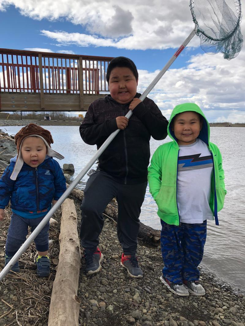 From left to right: Atlas Qaqaq Harpak, Charles Hunter, Jace Marayaq Harpak. Getting ready to go out smelting in Bethel, AK. Photo taken on May 23, 2018.