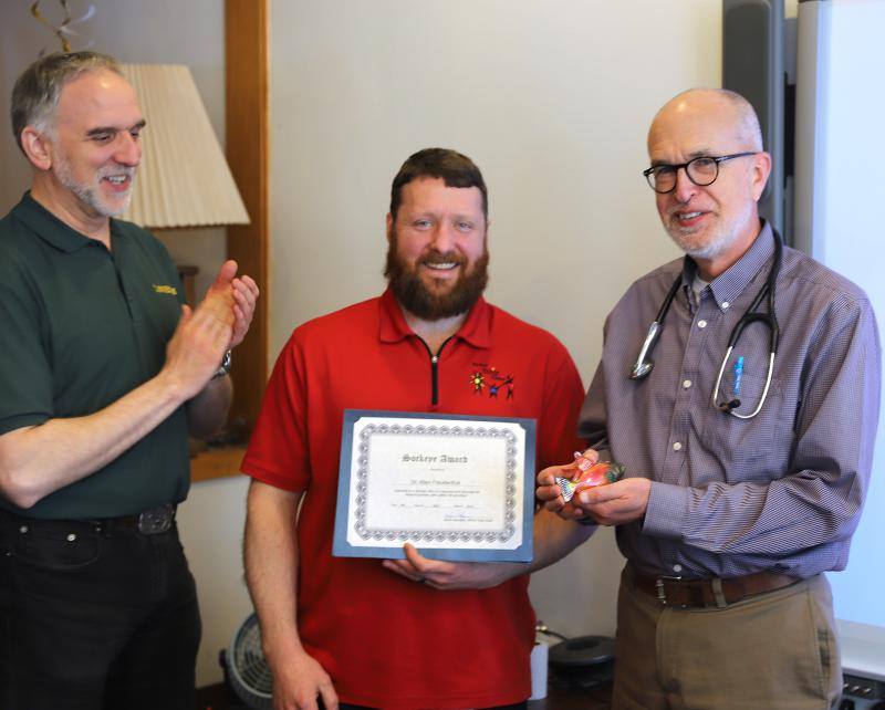 Bethel Family Clinic board chairman Don Black celebrates with Acting Executive Director Kyle McGrath and Dr. Allen Freudenthal. Freudenthal won the coveted Sockeye Award on May 14, 2018.