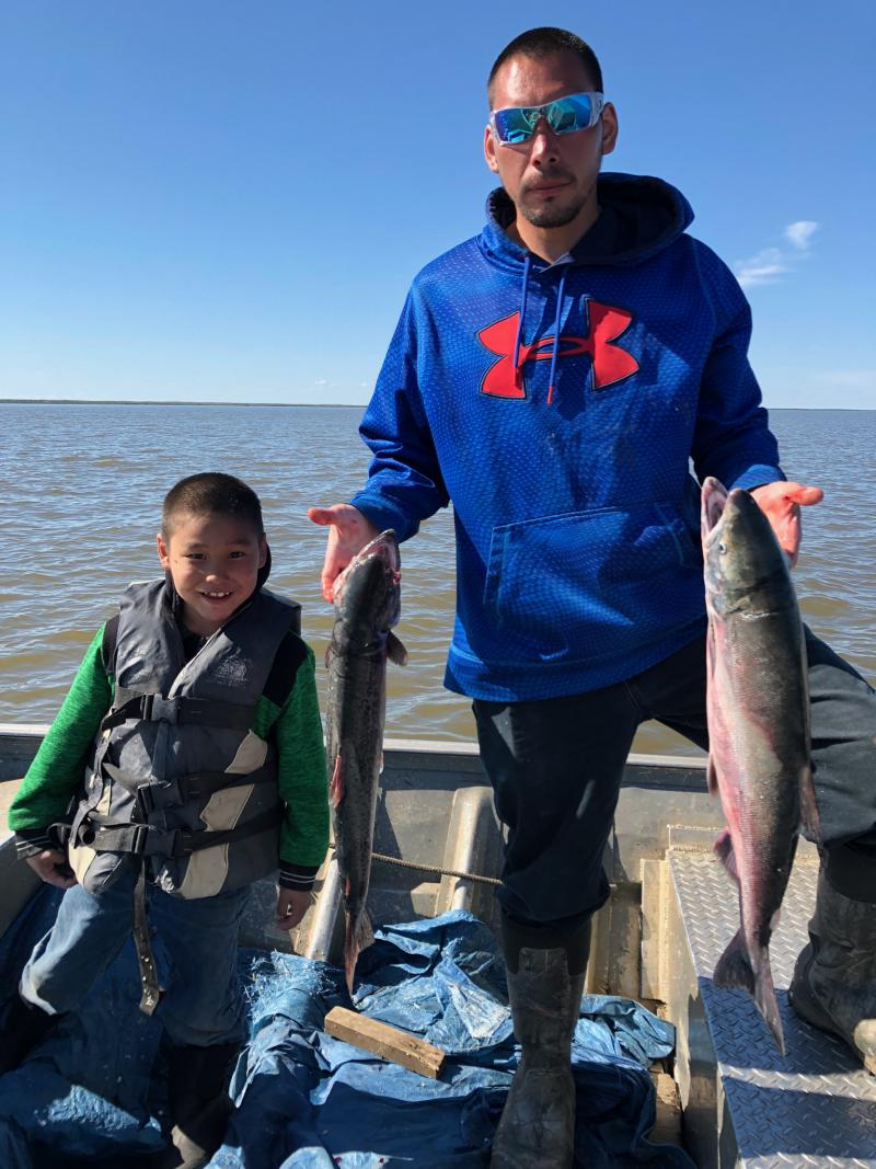 Conor White, age 6 and Kyle White from Kasigluk, AK enjoyed their time together gathering subsistence fish for the winter on June 12, 2018.
