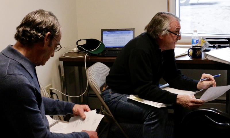 Bethel City Manager Peter Williams [left] and Former Finance Director Jim Chevigny [right] reviewing the FY2018 budget at Bethel City Hall on June 8, 2017.