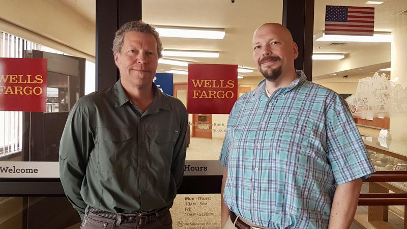 Sea Share Executive Director Jim Harman [left] pictured with Bethel's Wells Fargo branch manager Jon Cochrane [right], who also serves as Bethel's Lions Club President. July 19, 2018.