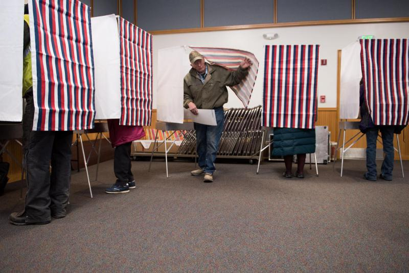 Bill Ferguson exits a voting booth at the Yupiit Piciryarait Cultural Center, one of two available precincts in Bethel, Alaska on November 8, 2016.